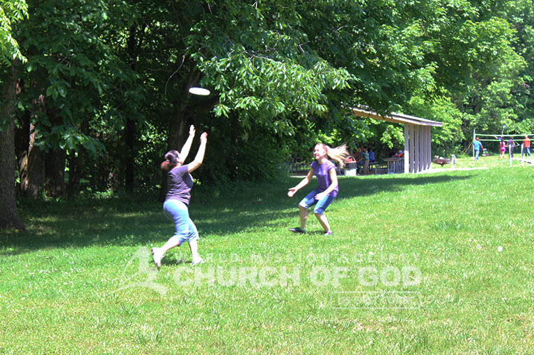 Two World Mission Society Church of God members playing Frisbee during Taylorsville Lake Family Cookout