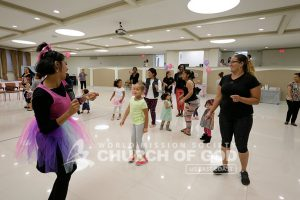 World Mission Society Church of God member leading Mommy and Me Dance Class