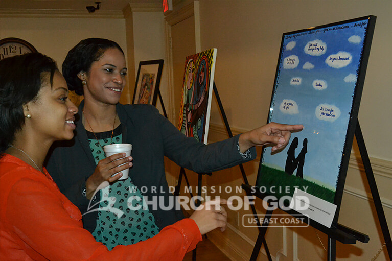 viewing art pieces during World Mission Society Church of God Mothers Love Art Exhibition