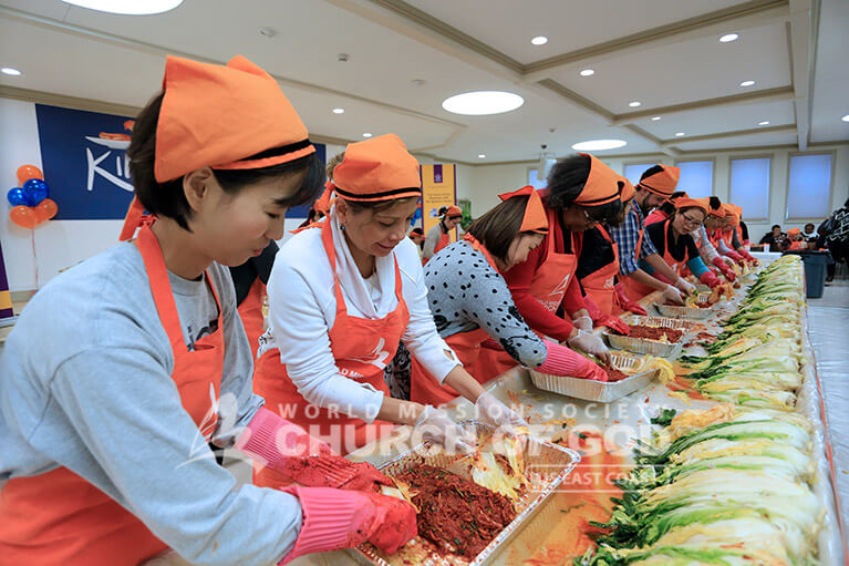 World Mission Society Church of God members and guests making kimchi during the Hudson Valley Kimchi Festival 2016