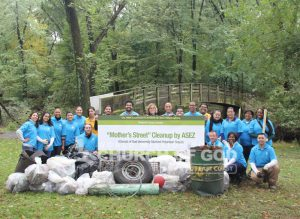 Group photo of ASEZ volunteers from the World Mission Society Church of God after Mothers Street cleanup at Contant Park