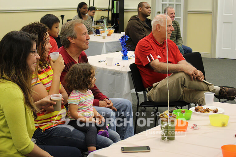 World Mission Society Church of God and guests laughing during Father's Day Appreciation Event 2015 in Hudson, NH