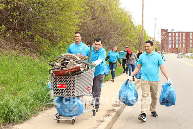 ASEZ volunteers removing trash from alongside Allard Drive in Manchester, NH
