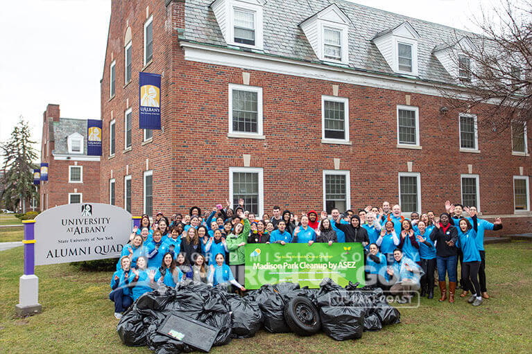 Group photo of ASEZ volunteers from UAlbany and other colleges during their Madison Park cleanup.