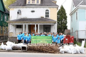 ASEZ members taking a group photo at the end of their vacant property cleanup in Syracuse, NY