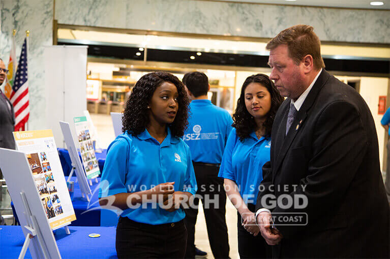 ASEZ volunteer explaining ASEZ's volunteer work to Assemblyman Chris Tague