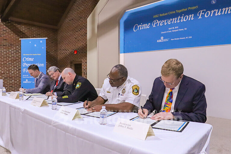 Police Chief Steve Drew, Sheriff Gabe Morgan, Professor Daniel Warman, and attorney Jeffrey Riddle signing to support ASEZ.
