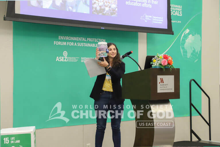 Girl explaining something to ASEZ WAO members during the Environmental Protection Forum