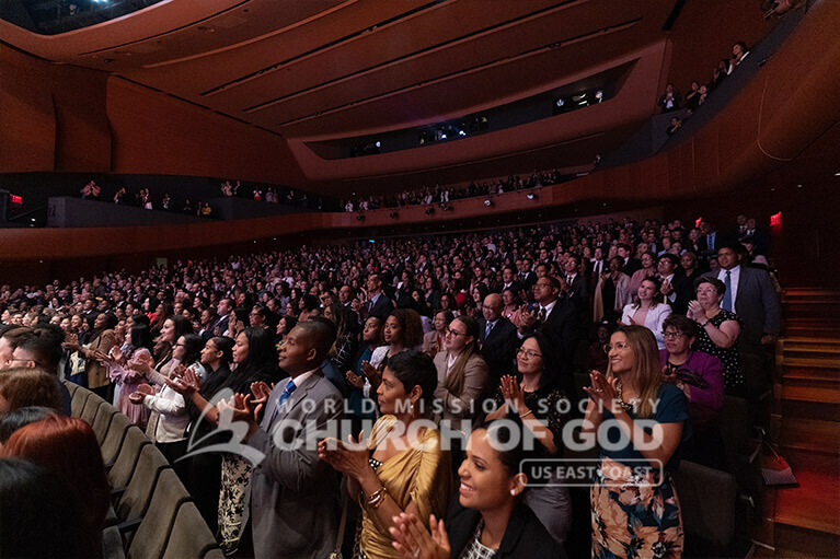 Audience members giving a standing ovation at the end of the ASEZ concert on August 11