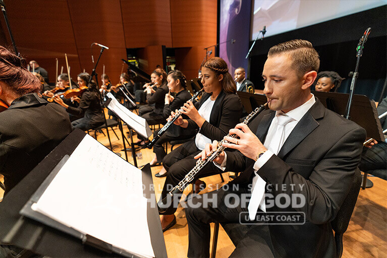 The winds section of the Church of God Orchestra performing at the Lincoln Center on August 11