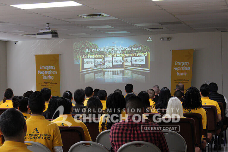 Emergency Preparedness Training attendees watching the Church of God intro video