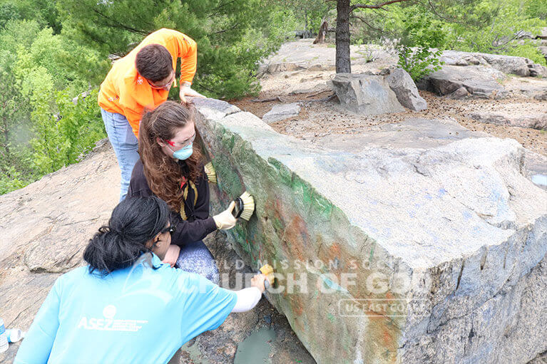 Volunteers from ASEZ removing graffiti at the Cranberry Lake Preserve