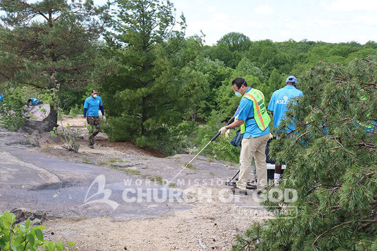 ASEZ volunteers removing graffiti at the Cranberry Lake Preserve in North White Plains, NY