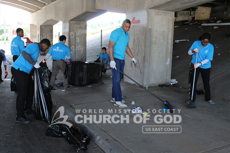 Volunteers from ASEZ removing garbage from around the JCTC campus