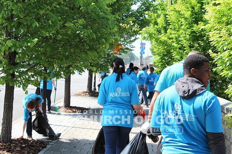 ASEZ volunteers cleaning trash from the sidewalk near JCTC