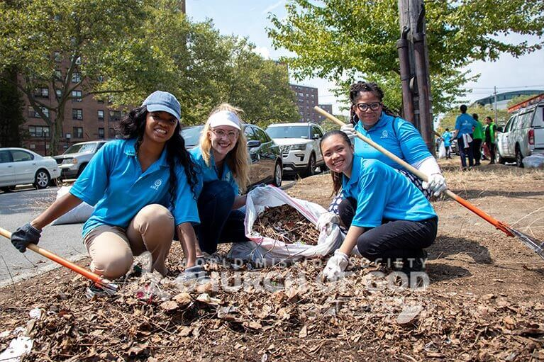 ASEZ volunteers joyfully removing trash from Randall Ave in the Bronx