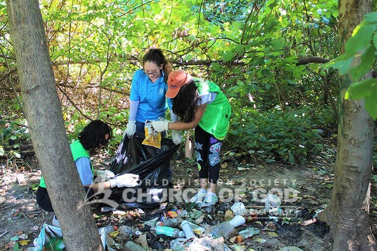 ASEZ volunteers removing a pile of trash from Pelton Park
