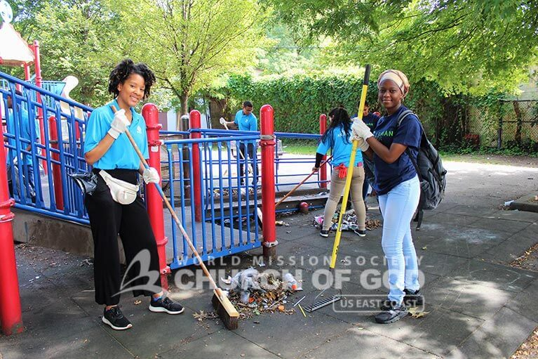ASEZ volunteers removing trash from a playground at Pelton Park