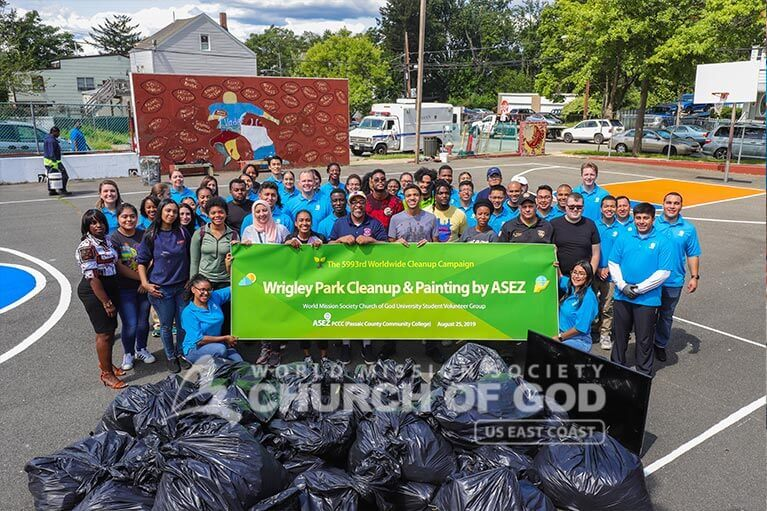 Group photo of ASEZ student volunteers during their Wrigley Park cleanup in Paterson, NJ.
