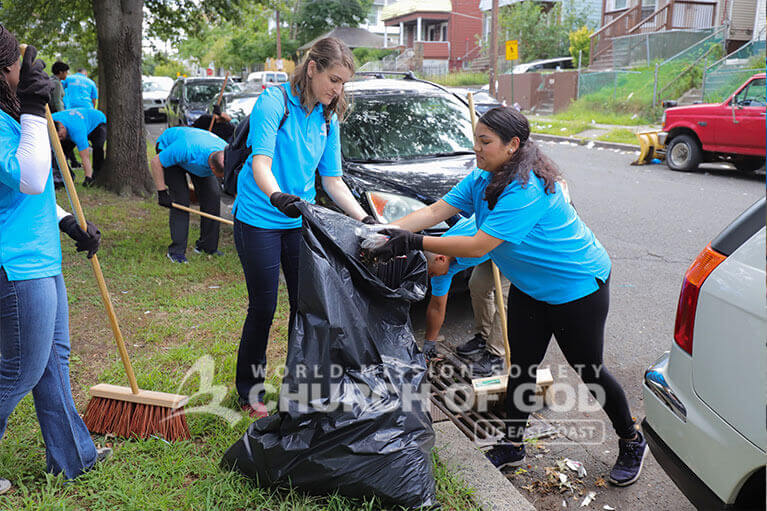 ASEZ volunteers working together to clean up the Wrigley Park neighborhood of Paterson.