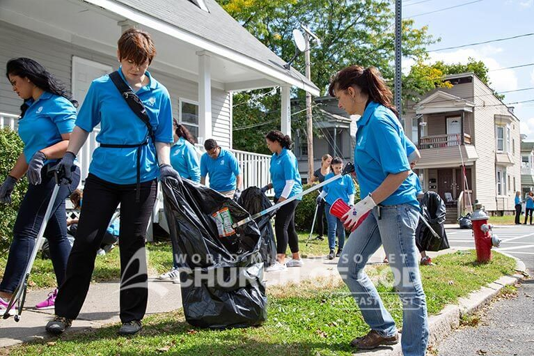 Judge Regina Rinaldi cleaning up trash in Albany with ASEZ.