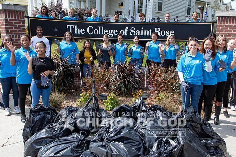 ASEZ student volunteers group photo with the garbage they collected in front of the College of Saint Rose.