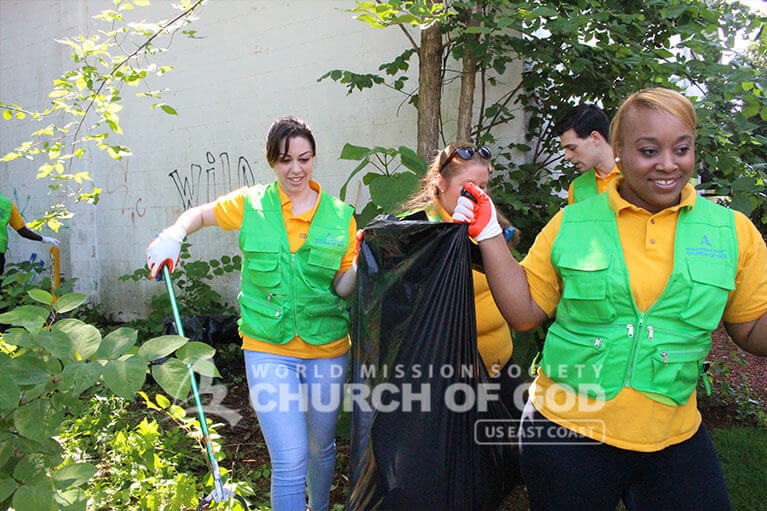 World Mission Society Church of God volunteers clean up Howard Street in Nashua, NH.