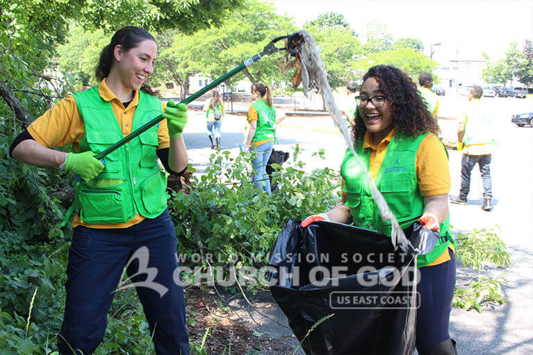 WMSCOG members joyfully picking up trash from Howard Street in Nashua.