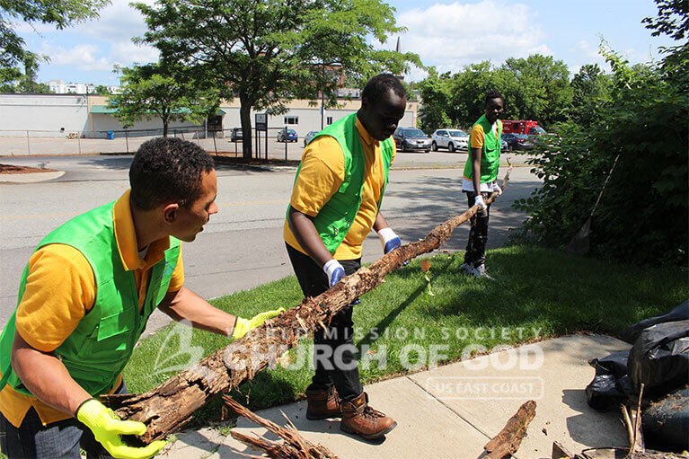WMSCOG volunteer removing large pieces of debris from Howard Street in Nashua, NH.