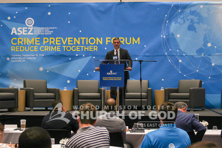 Professor Luke Milligan speaking to students during the Crime Prevention Forum at the University of Louisville