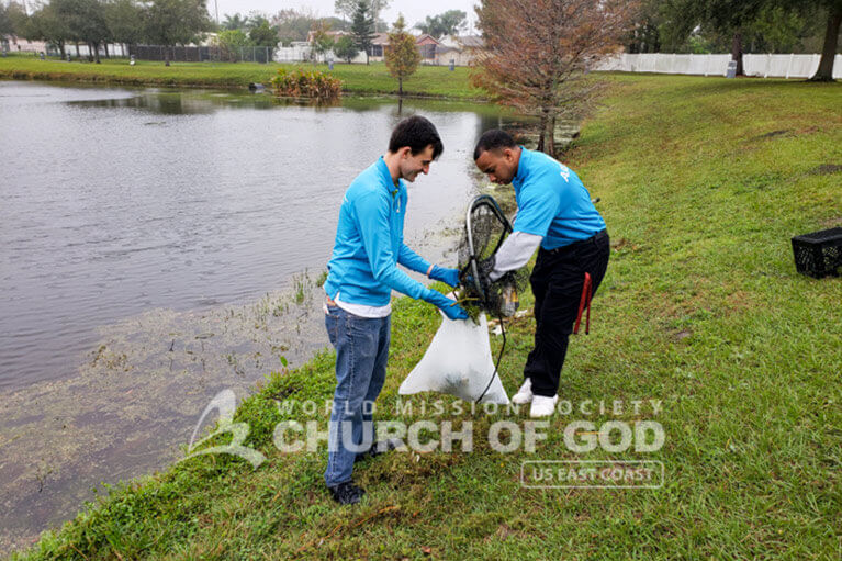 Volunteers from ASEZ cleaning Leroy Hoequist Park.