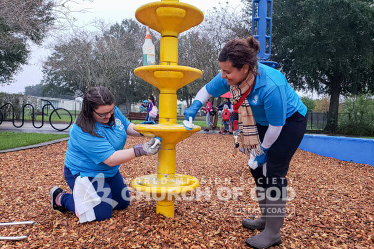 ASEZ student volunteers cleaning the playground at Leroy Hoequist Park.
